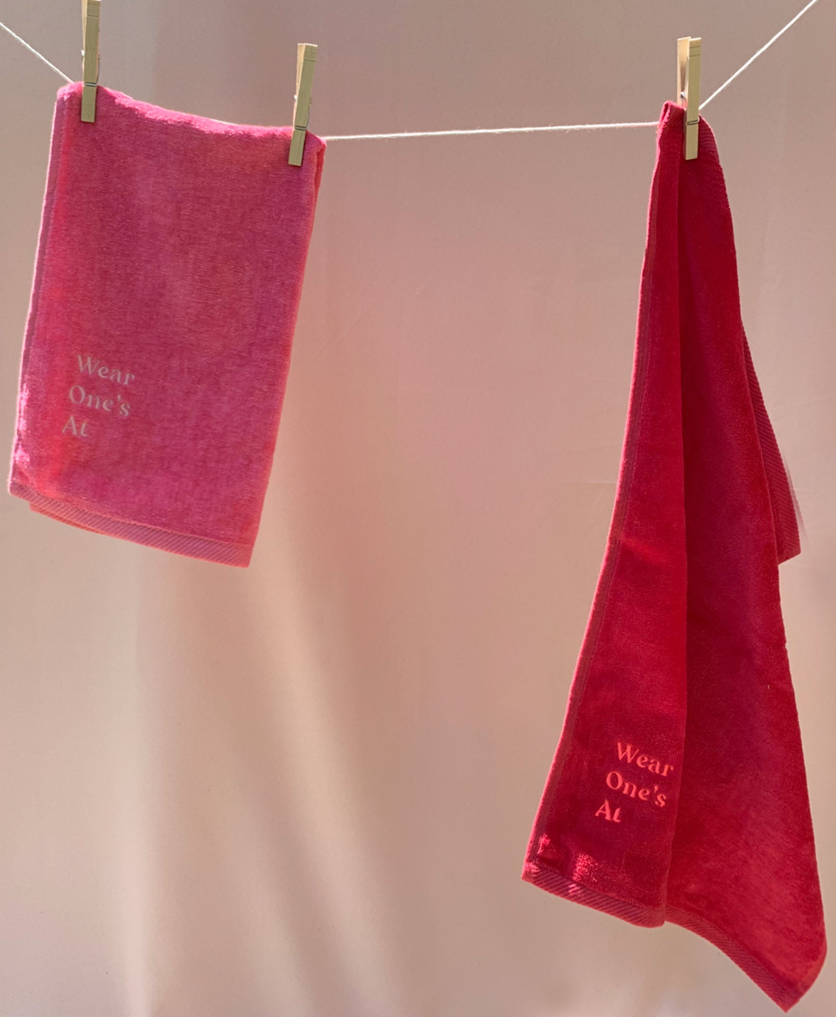 Wear One's At Logo Sport Towel in Punch Pink and Cherry Red