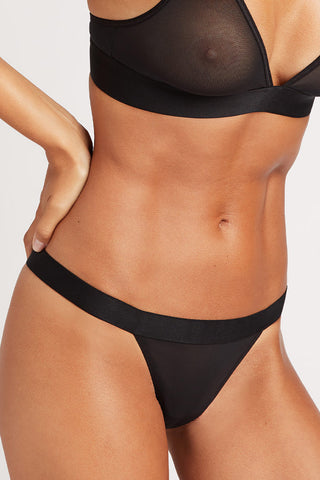 Thumbnail image #1 of Sieve Thong in Black, worn by Paula, size XS