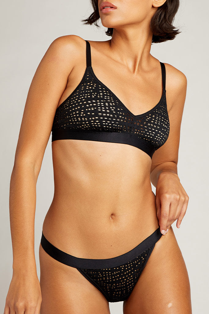 Perforated lace texture is edgy meets understated sexy