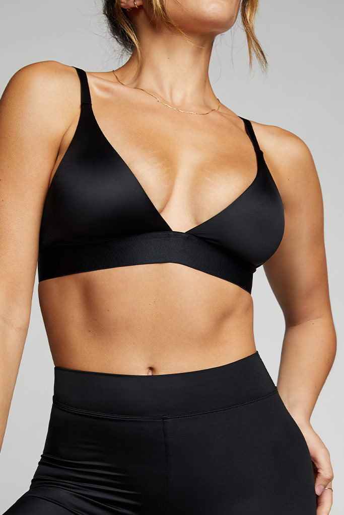Deep v neckline is low coverage at the front and sides