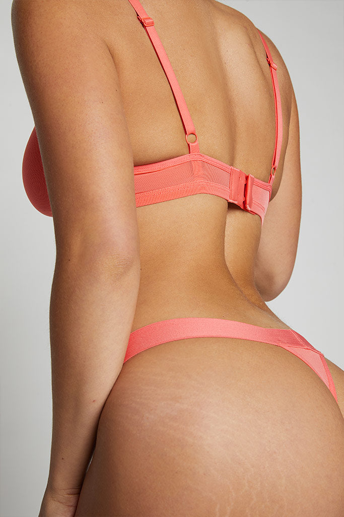 Shown here with our Sieve Thong in Coral
