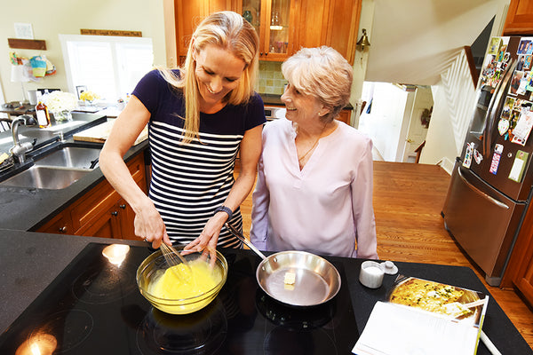 Cassandra & Barbara making Ina Garten's Truffled Scrambled Eggs.