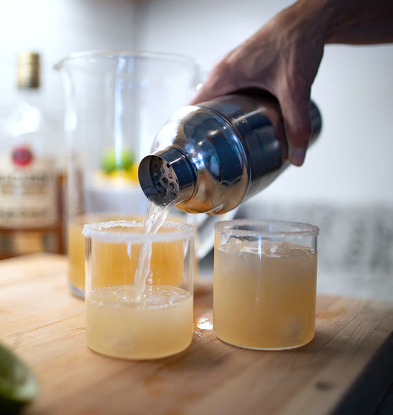 Pouring a cocktail into a double old fashioned glass