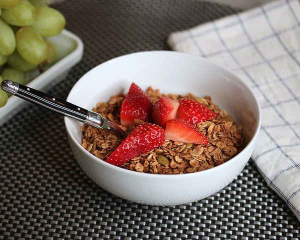 Homemade granola with fresh berries served in our Cereal Bowl - White Dinnerware.