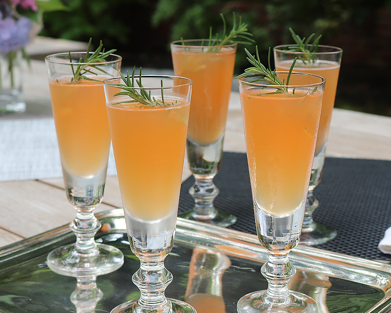 4 La Rochere Antoine champange flutes with cocktail and garnish
