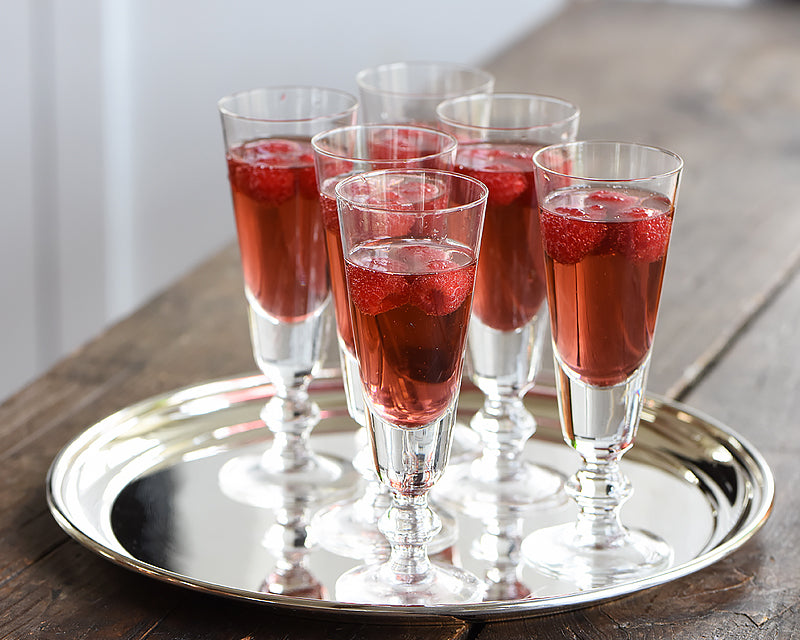 6 La Rochere Antoine Champagne Flutes with red cocktail garnished with raspberries