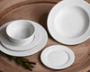 Pillivuyt White Dinnerware Collection including a dinner plate, salad plate, dessert plate, cereal bowl, and soup bowl.