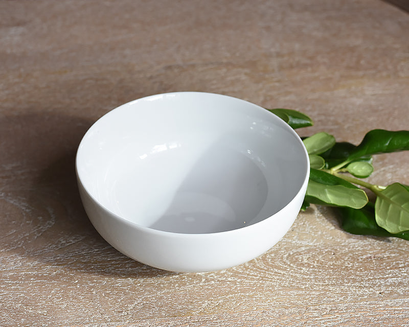 White Pillivuyt cereal bowl next to greenery