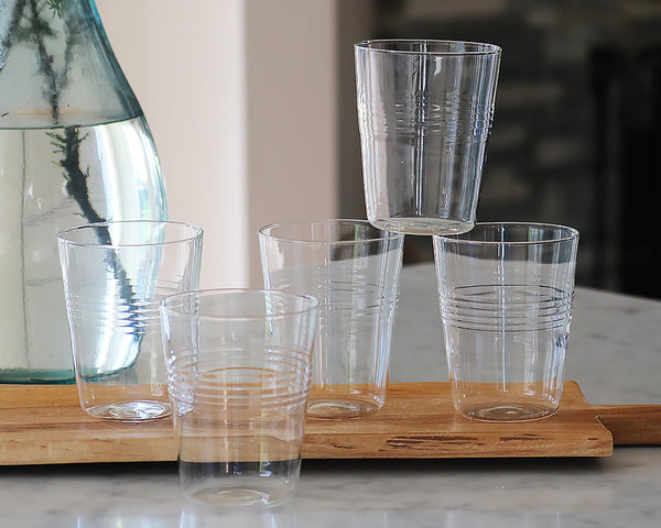 6 farmhouse borosilicate glasses stacked on wooden cutting board