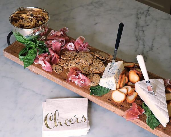 Wood Feasting Board layered in cheese, crackers and salted meats