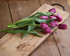 Wood Feasting Board on a table with a bunch of tulips