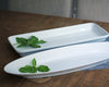 Oblong Fish Platter by Pillivuyt sites next to the Buffet Presentation Tray. Two lovely oversized platters ready to serve.