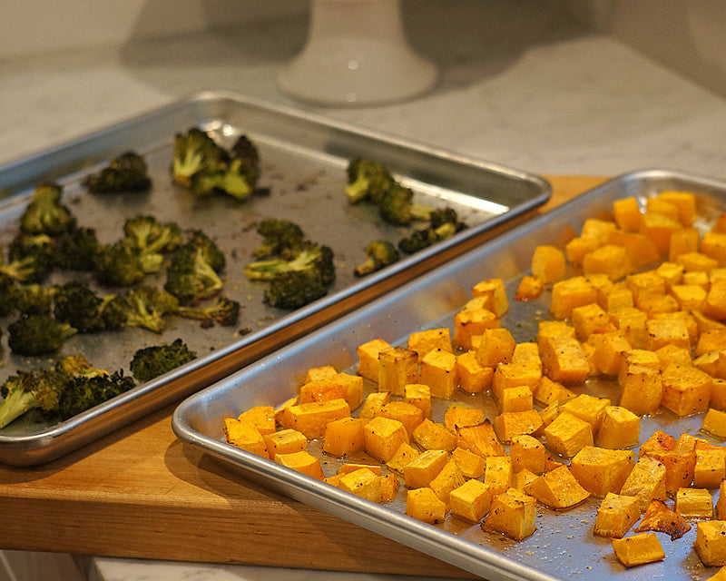 Ina Garten recommended Professional Half Sheet Pans cooking broccoli and potatoes.