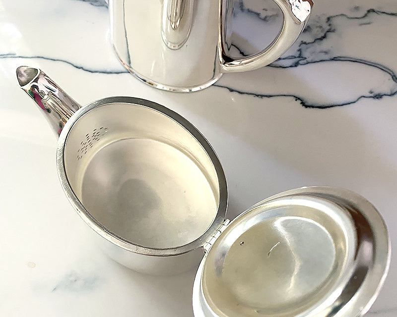 The inside of the Vintage HÔTEL Silver Teapot is in pristine condition.
