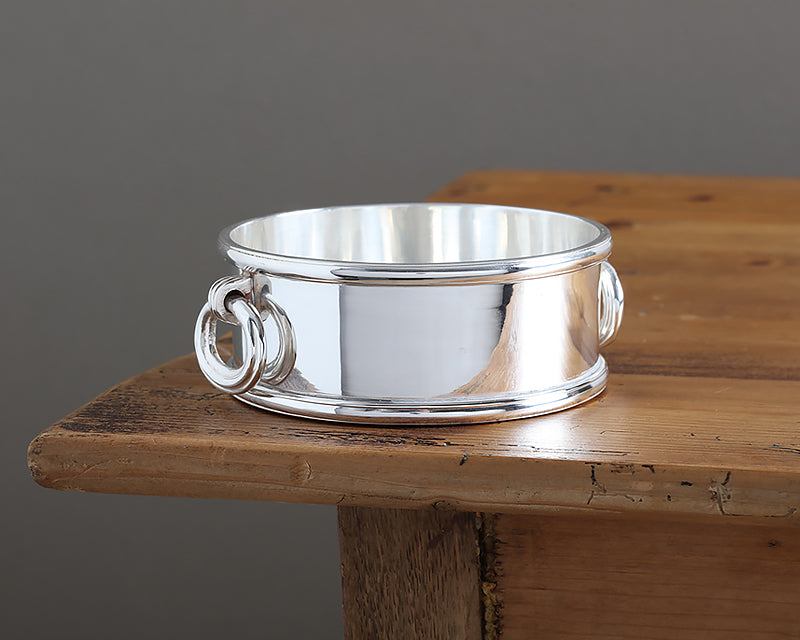 HÔTEL Silver Wine Bottle Coaster with solid flat base and thick ring handles.
