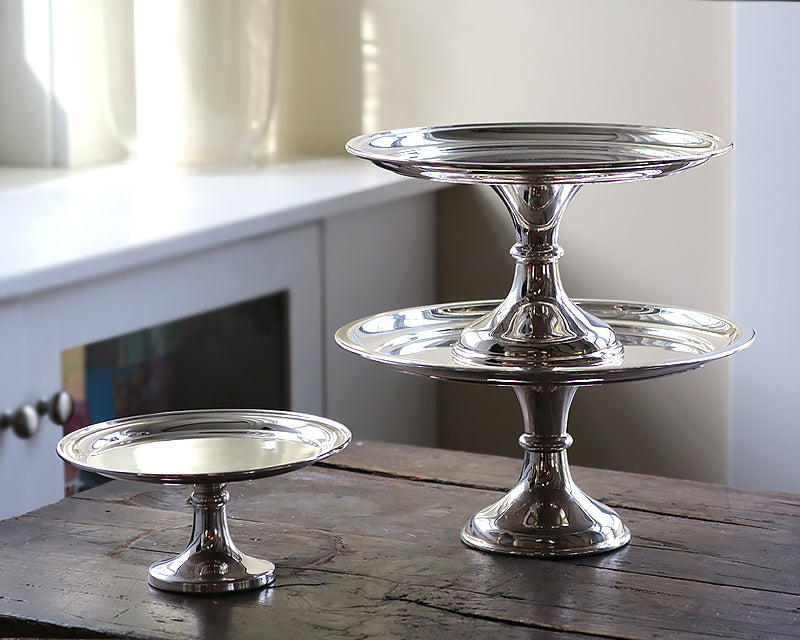 12, 10, and 8 inch vintage silver plated HÔTEL Silver Cake Stands on wood table