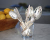 HÔTEL Vintage English Kitchen Spoons in a glass mixed with HÔTEL Silver Spreaders and Chowder Spoons