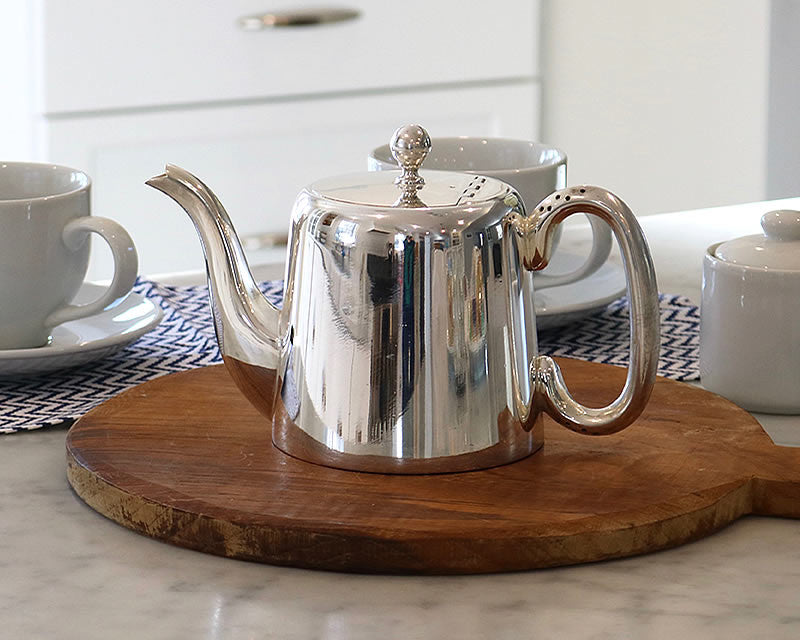 Ina Garten recommended HÔTEL Silver Teapot with tea cups on counter