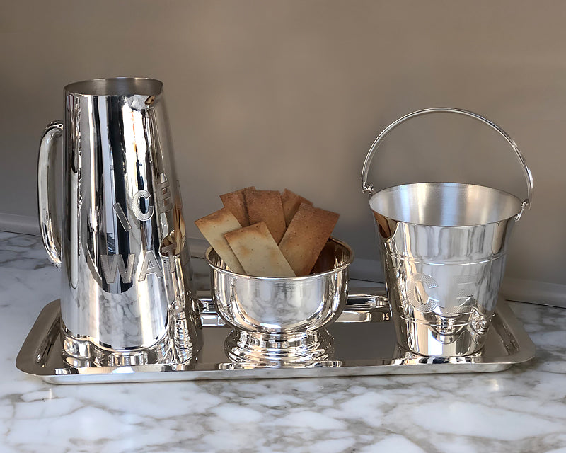 Silver cold drink pitcher, ice pail, and pedestal bowl from the HÔTEL Silver collection