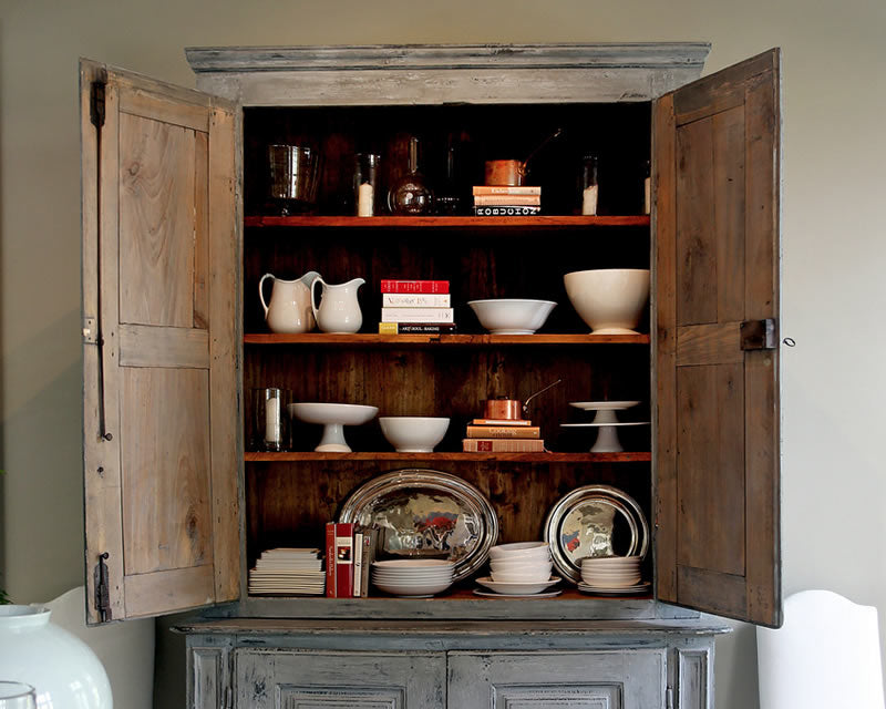 Ina Garten's kitchen cabinet displaying items from the HÔTEL Silver collection