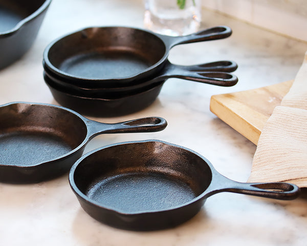 Mini cast iron skillets on countertop