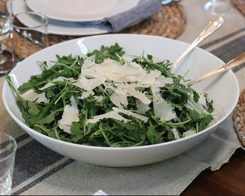 Big White Cecil Bowl filled with arugula salad and shards of fresh parmesan.