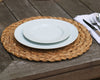 Classic white salad plate stacked on a white dinner plate on a woven placemat