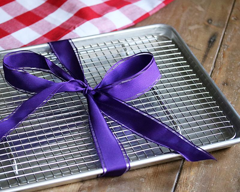 Half Sheet Pan with Cross Wire Cooling Rack wrapped in a holiday ribbon