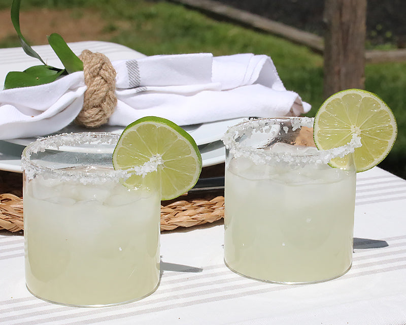 cocktail glasses garnished with lime