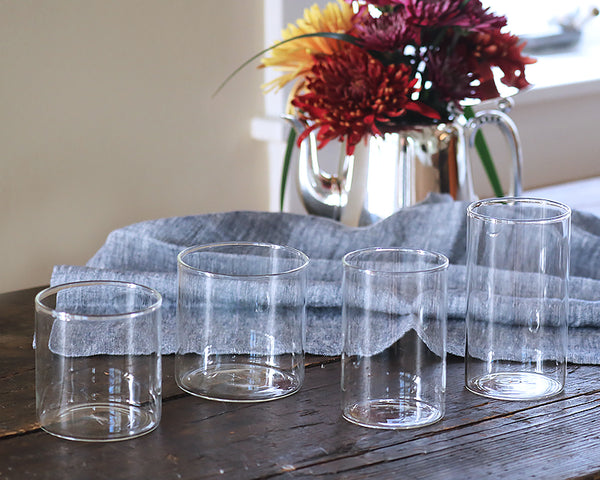 Simple Glassware Collection on a dining table next to a fall bouquet of flowers