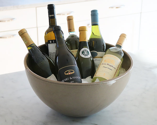 display multiple bottles on ice in the Extra Large Sintra Bowl.