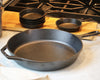 12-Inch Cast Iron Skillet on a counter top next to the mini Cast iron skillets