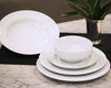 Pillivuyt dinnerware stacked including white dinner plate, salad plate, dessert plate, soup bowl, and cereal bowl