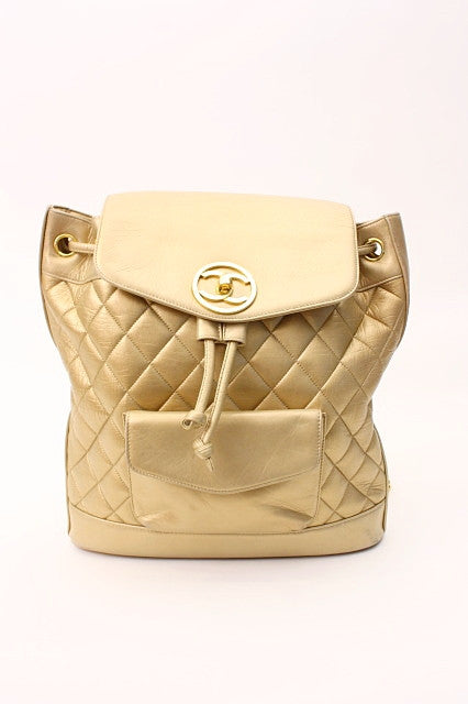 6ad038f5ab5a14 Vintage Chanel Gold Backpack at Rice and Beans Vintage