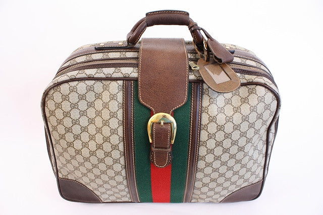 vintage 70 s gucci luggage at rice and beans vintage