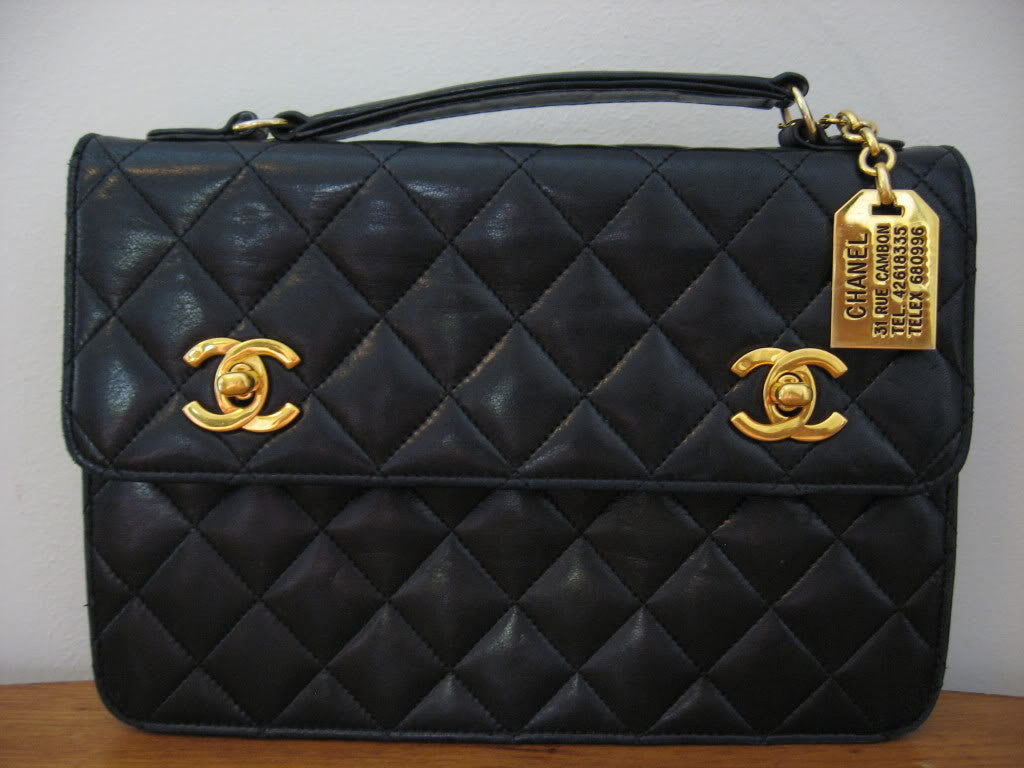 Vintage 80's CHANEL Quilted Black Leather Handbag with Gold & Leather Chain, CC Closure, & CHANEL Gold Name Tag, Converts to Top Handle Clutch