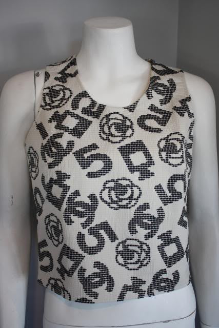 CHANEL 06P Quilted Tank Shell with CC Camellia Flowers, Perfume Bottles & More