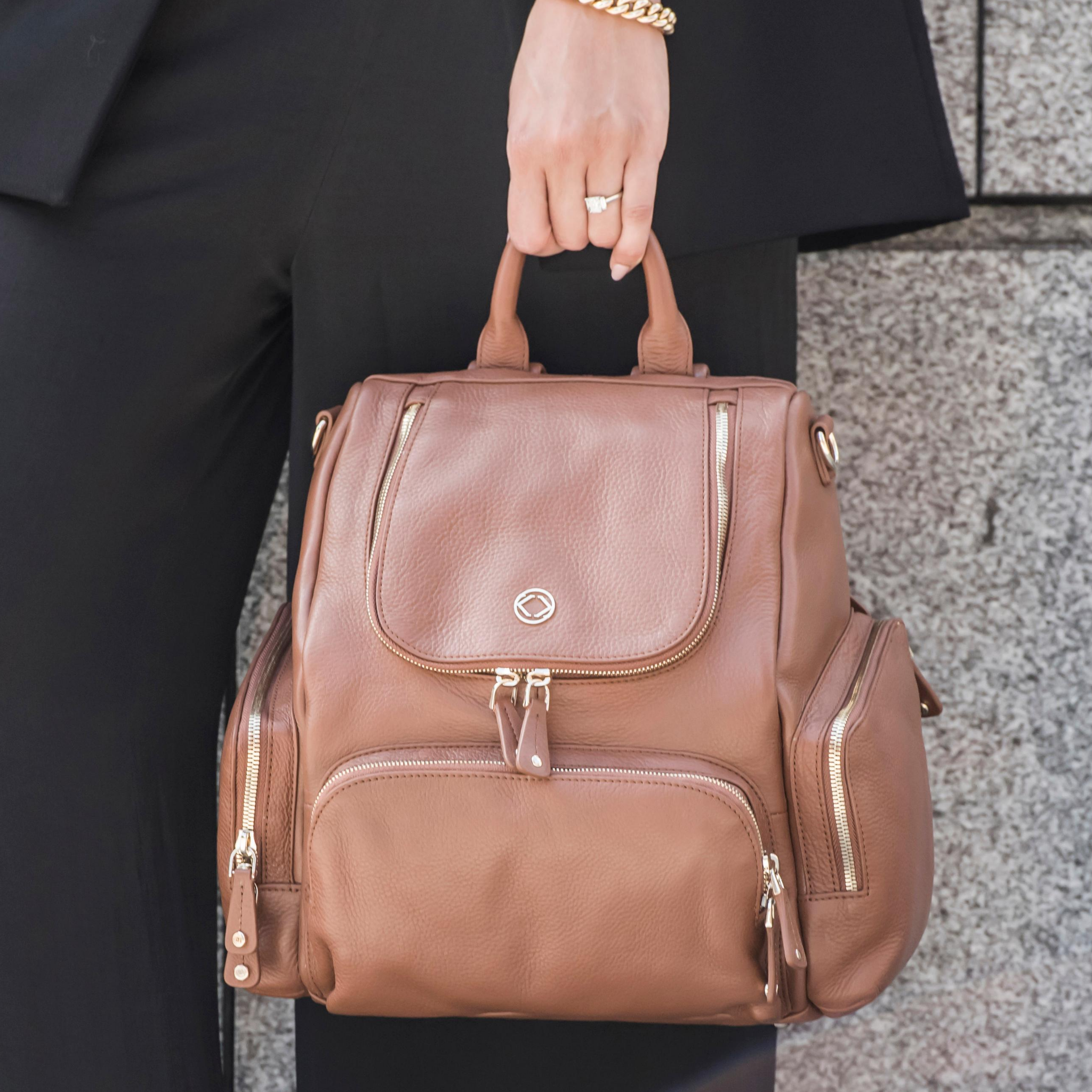 Be ready for anything with our women's tan leather backpack. Practical pockets and a beautiful design make this perfect for everyday adventures.