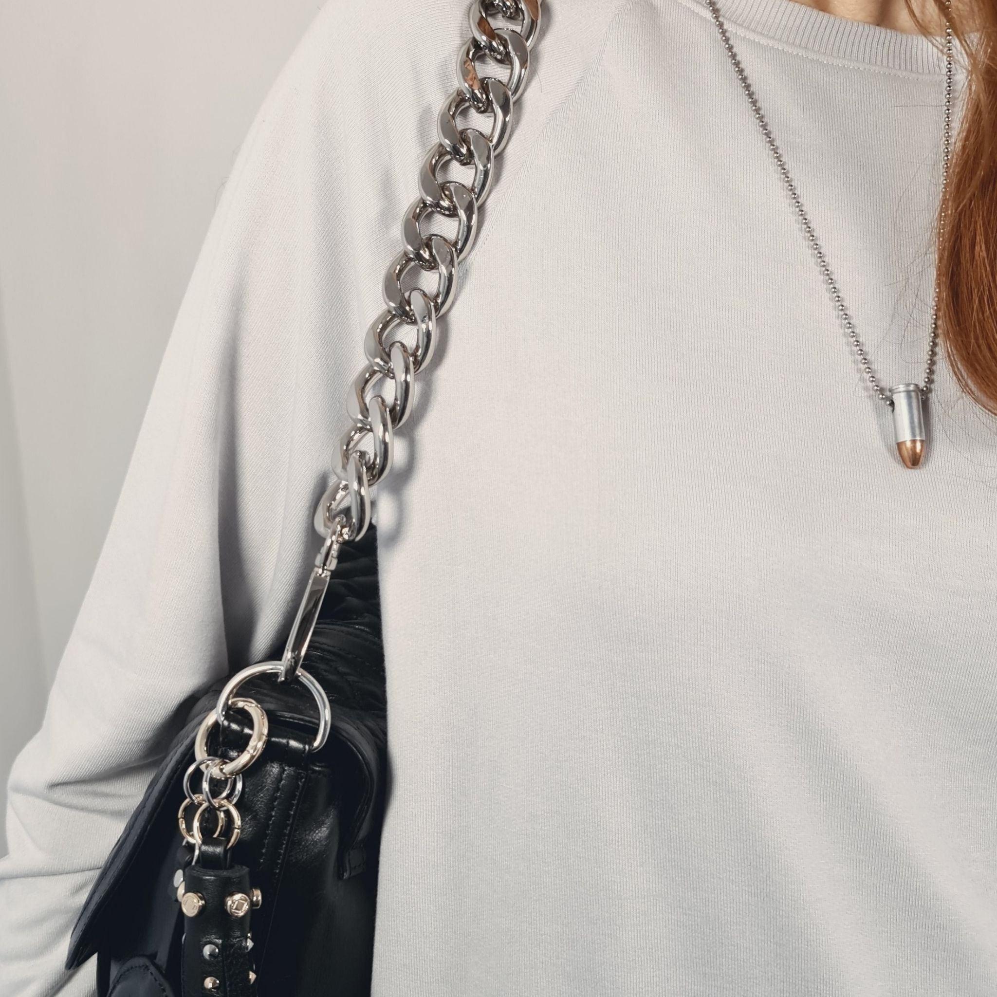 Luxury designer Jones black leather organiser crossbody changing bag with silver chain strap