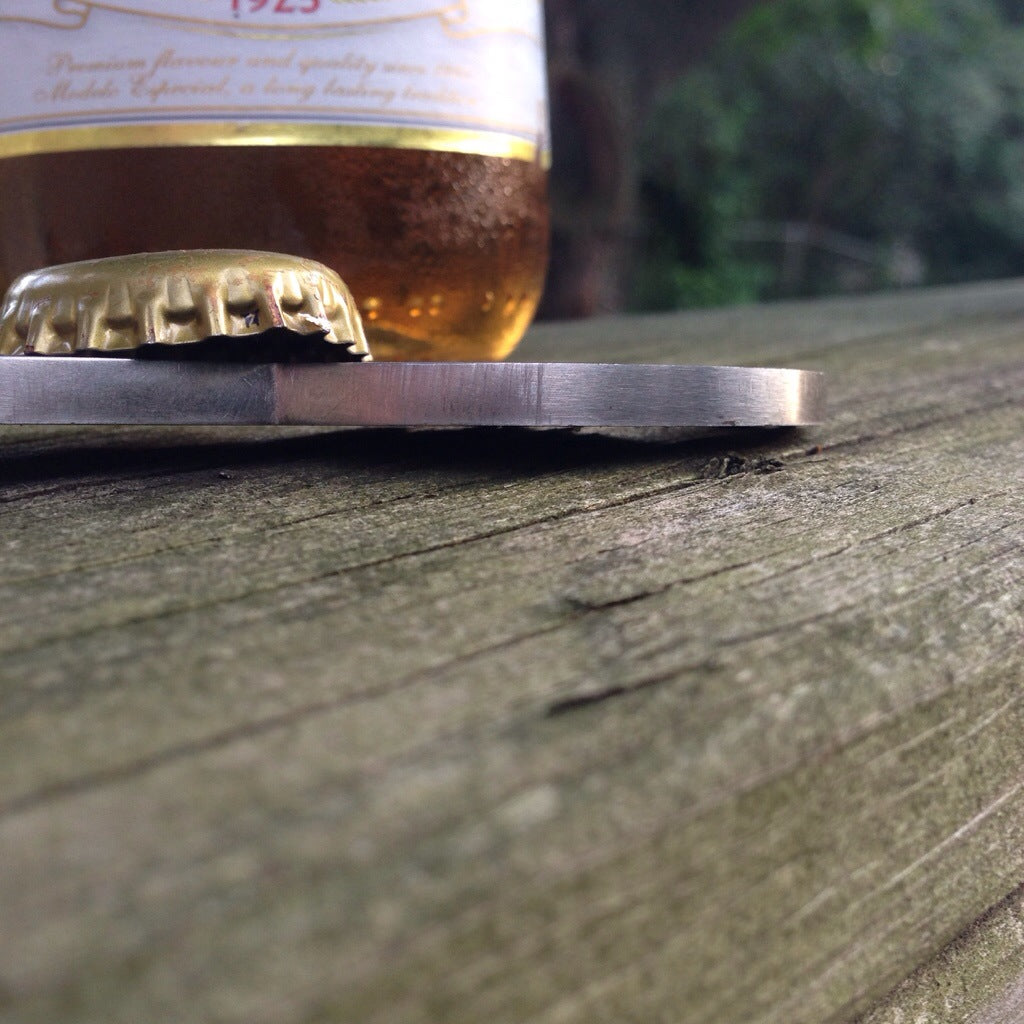 Close up of mustache bottle opener on railing