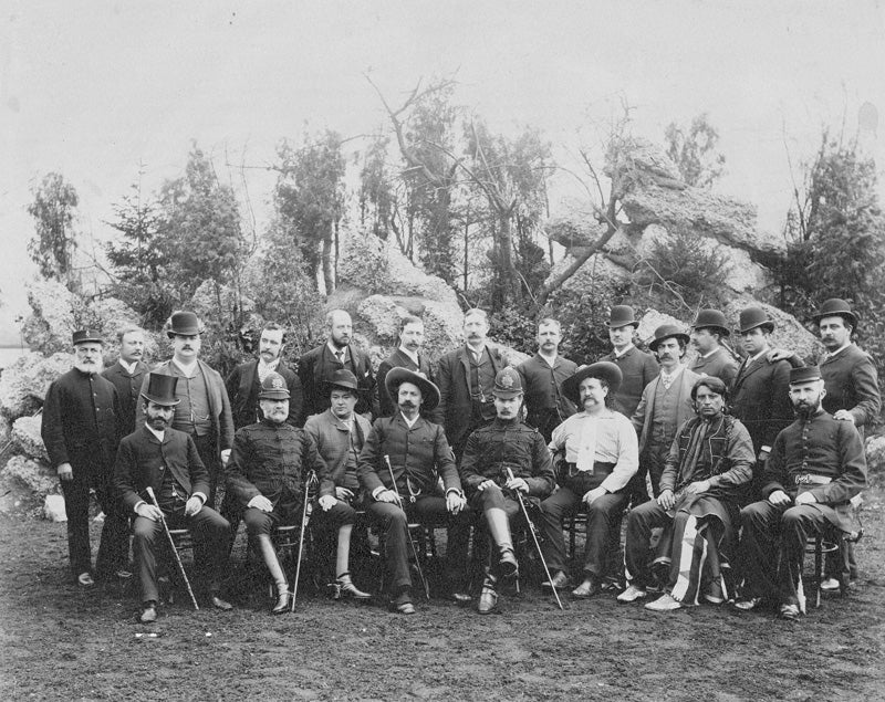 Group of men posing for old photo