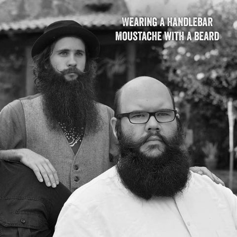 Wearing A Handlebar Moustache With A Beard
