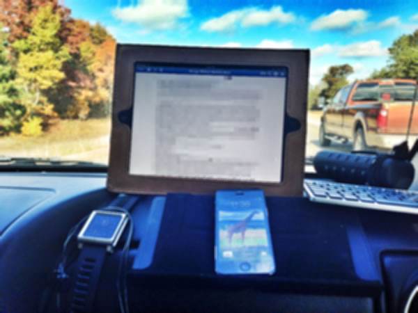 Office on the road ipad and iphone on dashboard