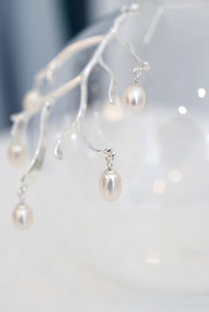 Closeup Freshwater pearl branch earrings silver