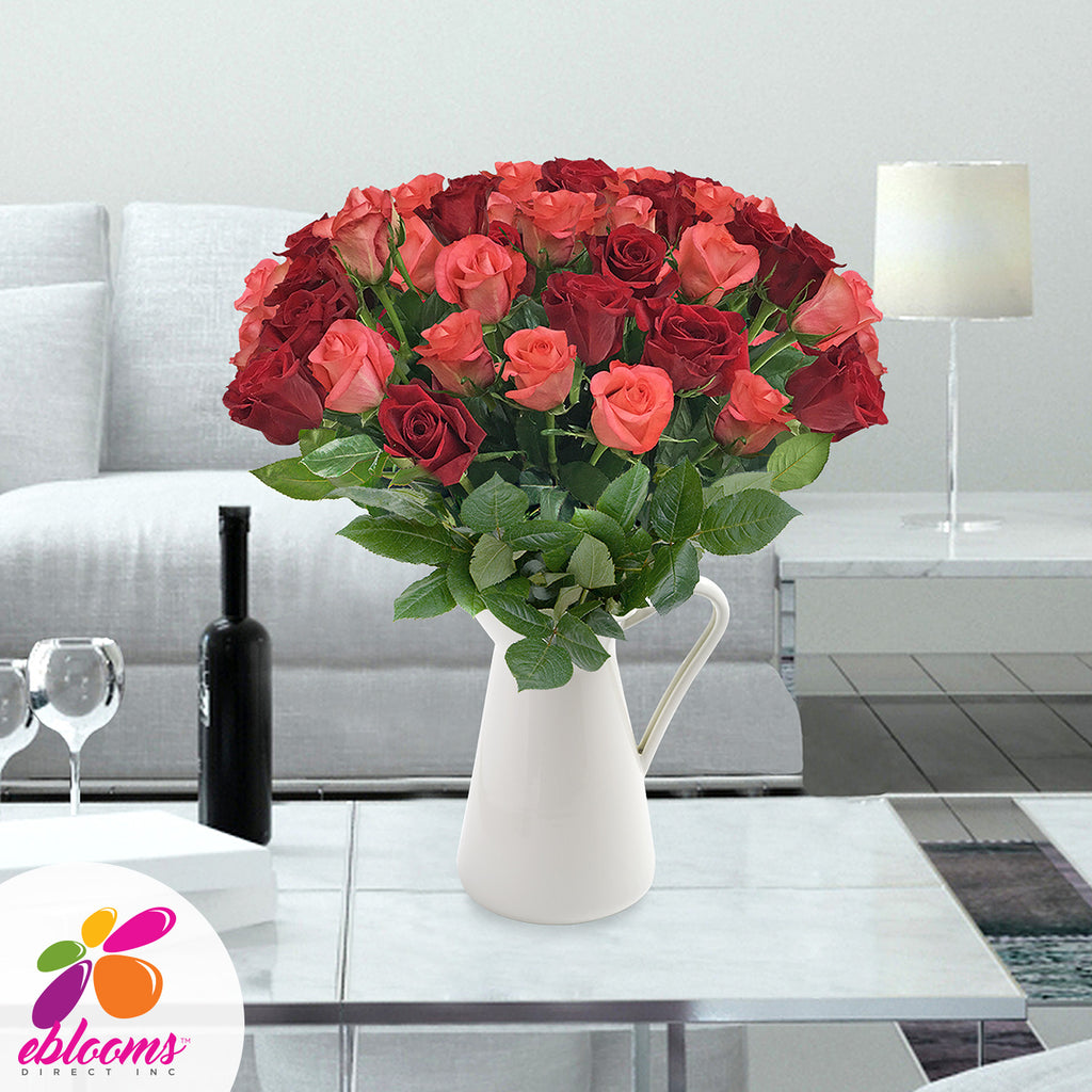 Red and Coral roses the best flower arrangement centerpieces bouquets to order online for any ocassion weddings, or event planners