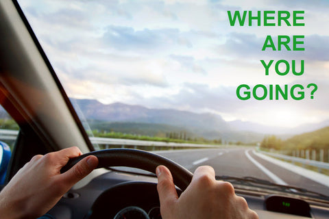 Person driving on the road, text overlay says Where are you going? Image represents the importance of goal setting and goal planning.