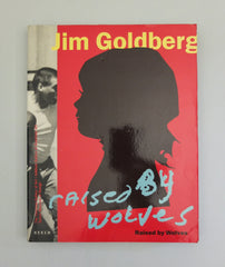 Raised by Wolves by Jim Goldberg (First)