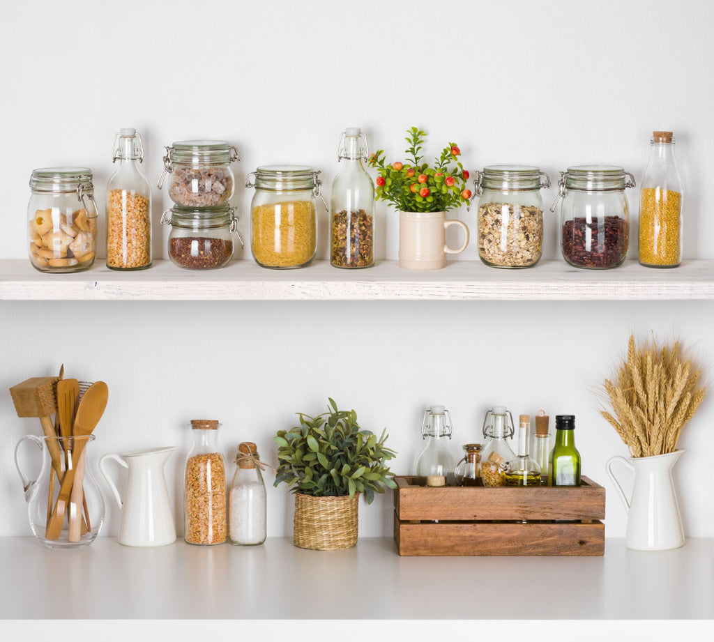 clean kitchen shelves with grains and cereals in sealed jars