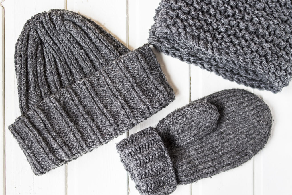 a gray woolen hat glove and scarf