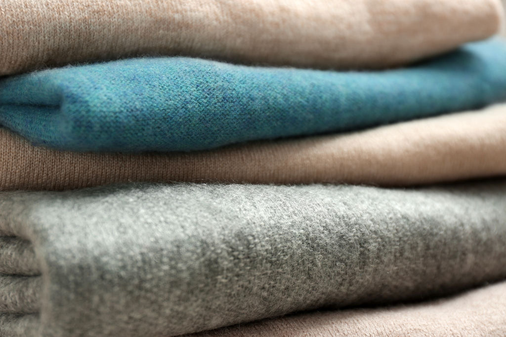 a folded pile of luxurious cashmere